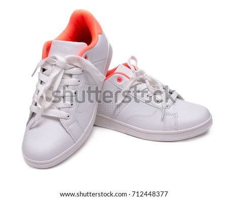 Pair of white sneakers isolated on white background. Sport shoes #712448377