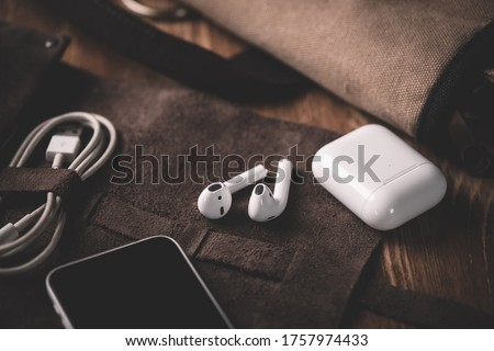 Pair of white wireless earbuds for smartphone. Relaxation concept. Stock photo ©