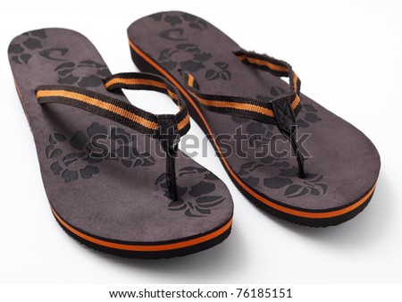 Pair of woman's sandal in brown color in white background.