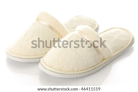 pair of women's fuzzy slippers with reflection on white background