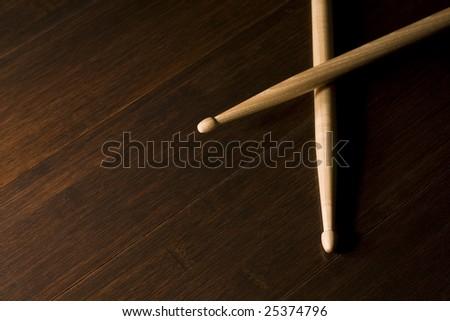 Pair of Wood Drumsticks on Bamboo floor