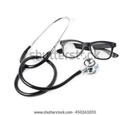 Pair of wooden textured optical reading glasses next to a medical stethoscope, composition isolated over the white background #450263203