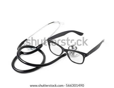 Pair of wooden textured optical reading glasses next to a medical stethoscope, composition isolated over the white background #566301490