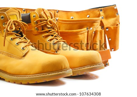 pair of working boots and tool belt isolated