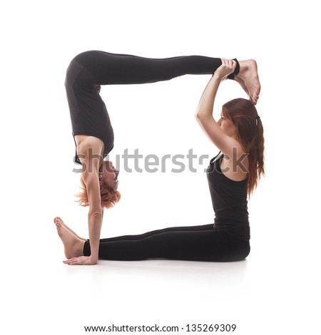 Paired Yoga Two Women Practicing On A White Background 135269309
