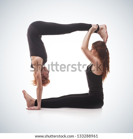 stock-photo-paired-yoga-two-women-practicing-yoga-on-blue-gradient ...