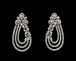 Pairs of Earrings with diamonds isolated over black background