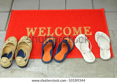 Pairs Of Foot-wares At The Door Step