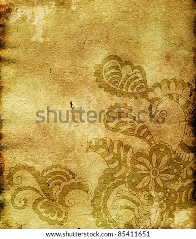 Paisley ornament on empty paper sheet (grunge background)