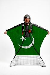 Pakistan flag travel. Bird Men in wing suit flag. Sky diving men in parashute. Patriotism, men and flag.