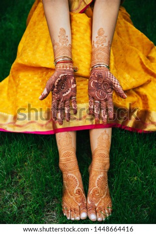 Pakistan Indian Bride showing foot and hand mehndi design