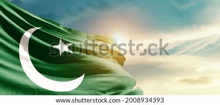 Pakistan national flag waving in beautiful sky.