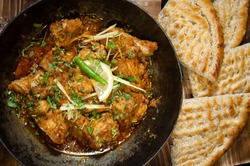 Pakistani Chicken Karahi with naan in traditional dish