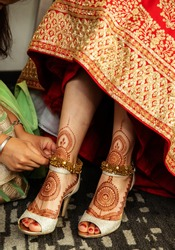 Pakistani Indian bride getting her anklets