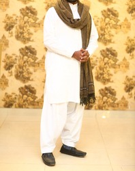 Pakistani Indian model wearing shalwar qameez dress