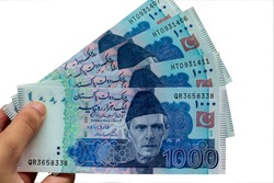 Pakistani 1000 Note hold in hand, Isolated on white background It is the local currency of the Pakistan.