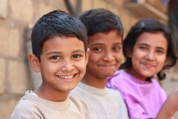 Pakistani siblings making pose and smile