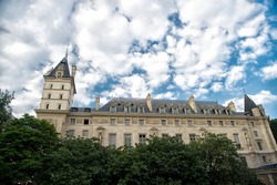 Palace in Paris France. Old building on cloudy sky. Classic architecture. Architectural style. Building and construction. Building architecture. Building open to nature. Sightseeing. Summer vacation.