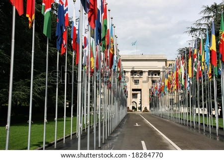Palace of Nations - seat of the United Nations in Geneva, Switzerland. Flags of all countries.