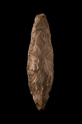 Palaeolithic javelin tip in perfect condition on black background
