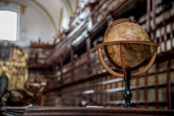 Palafoxiana library of Puebla Mexico, old with wooden furniture and thousands of old books with brown colors, large vaults, clocks and globes, old terraces, shelves and showcases from the 18th century