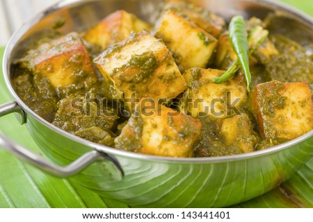 Palak Paneer - South Asian curry made with paneer (cheese) with pureed spinach sauce. Close up.