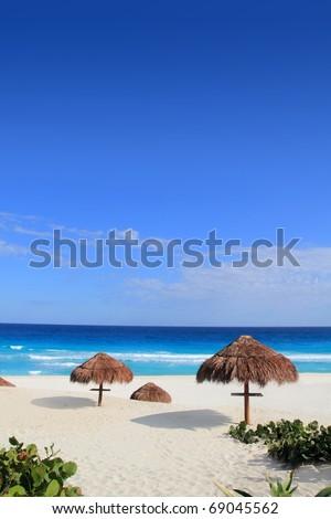 Palapa hut beach sun roof turquoise Caribbean Cancun Mayan Riviera