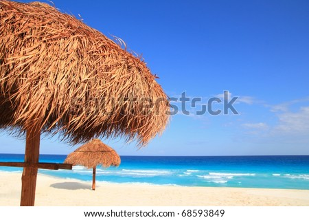 palapa sun roof beach umbrella in caribbean - stock photo