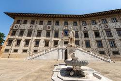 Palazzo della Carovana or dei Cavalieri. Ancient palace, building of the University (Scuola Normale Superiore di Pisa), in Piazza dei Cavalieri (Square of the Knights), Tuscany, Italy, Europe.
