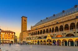 Palazzo della Ragione medieval town hall and palace of justice building, Torre degli Anziani tower in Piazza dei Frutti square in Padua historical centre, twilight evening view, Veneto Region, Italy