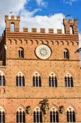 Palazzo Pubblico in Campo Square (Piazza del Campo) in Siena, Tuscany region, Italy. The historic centre declared by UNESCO a World Heritage Site.