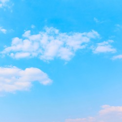 Pale blue sky with white clouds - background with space for your own text