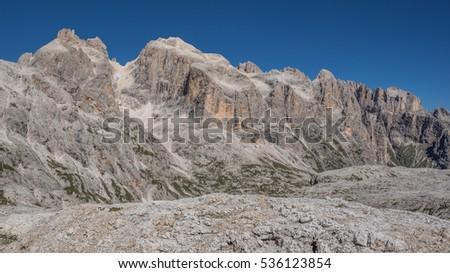 Pale di San Martino group summits from L to R; Cima Corona, Croda della Pala, Cimon della Pala, Cima Vezanna, Nuvolo, Cima dei Bureloni, Cima della Comelle seen from the high plateau, Dolomites, Italy Stock fotó ©