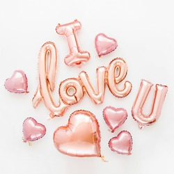 Pale pink Foil Balloons in the shape of the word