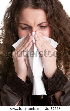 ... sick woman with a flu, sneezing, in a white background - stock photo