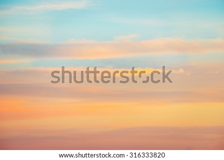 Pale sunset sky with pink, orange and red colors. Natural background