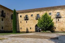 Palencia, Spain - August 21, 2021. Exterior facade of the Santa Maria la Real monastery, Aguilar de Campoo, Palencia, Spain.