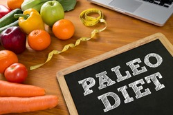PALEO DIET Fitness and weight loss concept, fruit and tape measure on a wooden table, top view, Blank board copy space