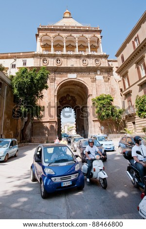 PALERMO, ITALY - JUNE, 24: traffic near Porta Nuova in Palermo, Sicily on June 24, 2011. Porta Nuova is magnificent gateway built in 1535 in honor of Emperor Charles V victory at Tunis.