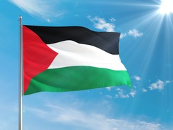 Palestine national flag waving in the wind against deep blue sky. High quality fabric. International relations concept.