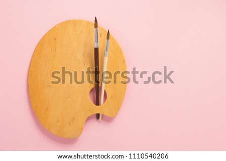 palette and paint brush on abstract background