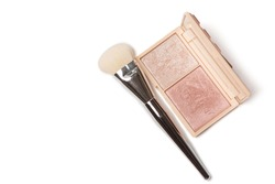 Palette of a pressed highlighters duo for face with a brush on a white background. Empty space
