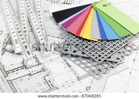 palette of color samples of plastics, PVC, for furnishing, metric folding ruler, perforated metal, coated with a polymer and architectural plans for houses