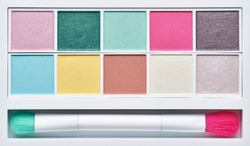 Palette of cosmetic eye shadow, pearlescent shades, with a brush for application, isolated on white background