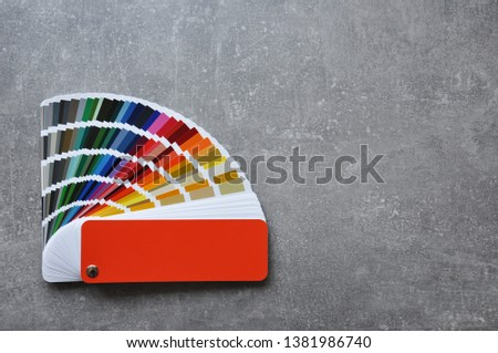 Palette of different colors and shades on concrete background. Color palette guide on grey background