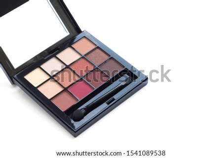 Palette of eyeshadows in brown tones, matte and shimmer eyeshadows isolated on white background, copy space. Autumn eyeshadow palette