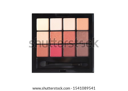 Palette of eyeshadows in brown tones, matte and shimmer eyeshadows isolated on white background, top view. Autumn eyeshadow palette