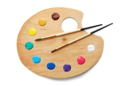 Palette with paints and brushes on white background, top view