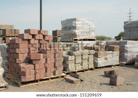 Pallet of red corner bricks at a building supply store.