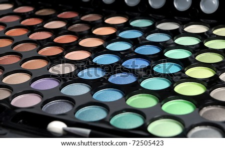 pallette with various colors of eyeshadows